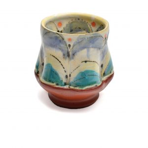 Colorful handmade ceramic wine cup with blue and white