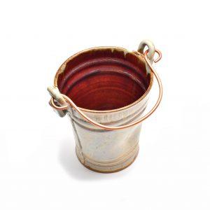 red and white ceramic bucket, wine cooler, fun kitchen gadget, unique utensil jar