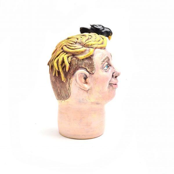 man head side view with bird bank, handmade bank