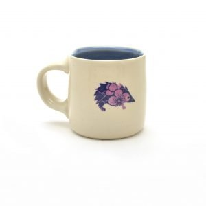 hedgehog mug, white thrown mug with hedge hog decoration, purple white and blue