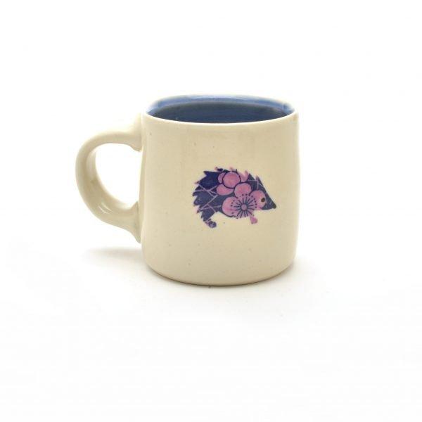 hedgehog mug, white thrown mug with hedge hog decoration, purple white and blue