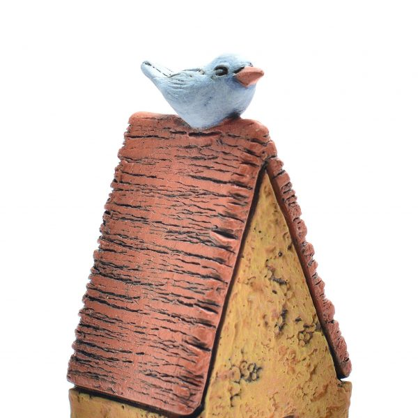 detail of top of clay house sculpture with blue bird, creative housewarming gift,