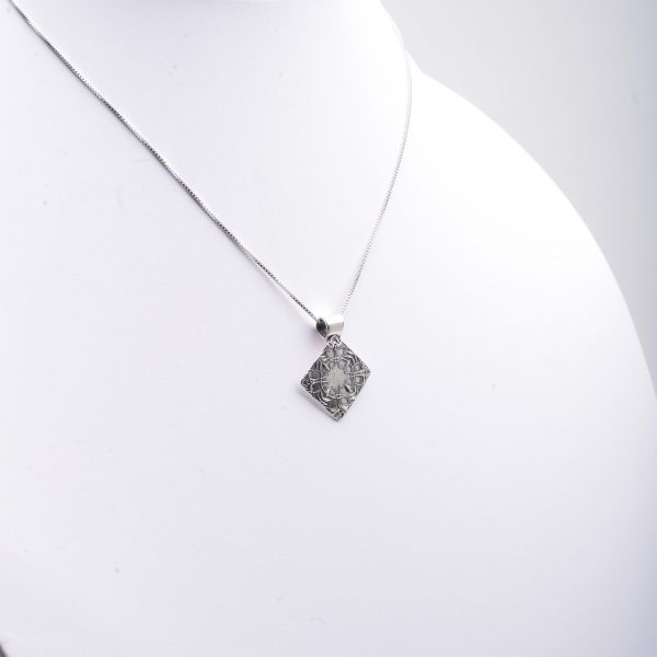 diamond shaped silver pmc necklace with zen image, precious metal clay silver, nc jewelery, nc craft jewelry