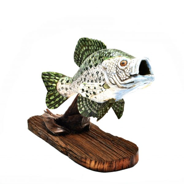 carved wooden fish, traditional wood carving, painted wooden fish on log