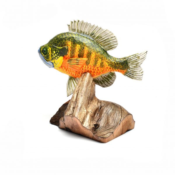 carved and painted wooden fish,