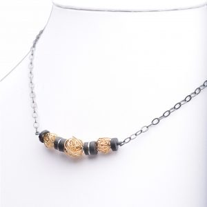 handmade necklace with gold nests and black onyx, asheville jeweler