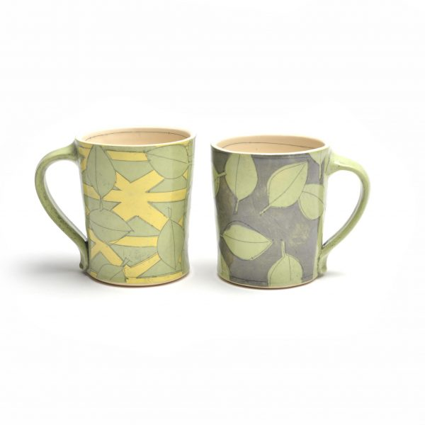 handmade ceramic mug with leaves and triangles, paper resist decoration