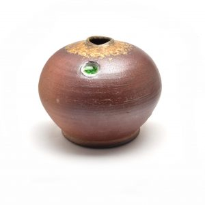small wood fired globe vase with green dot of glaze