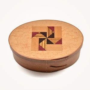 traditional wooden shaker box with veneer quilt square in lid