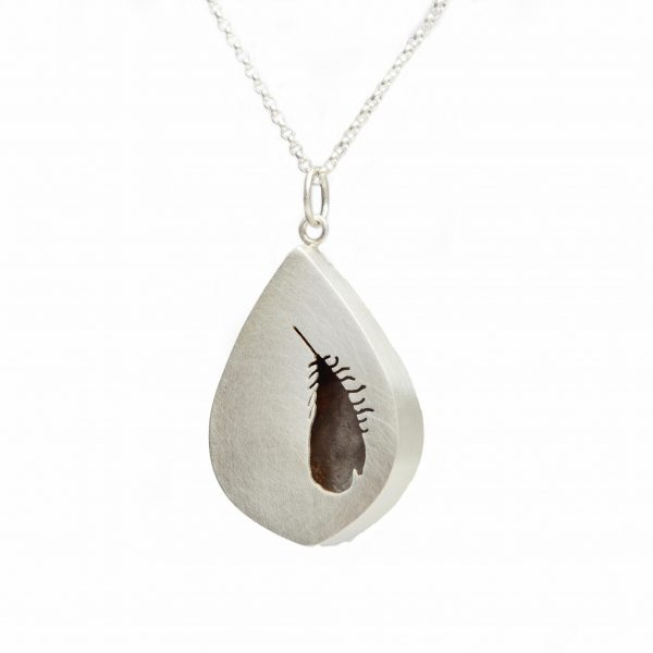 handmade silver necklace with feather silhouette