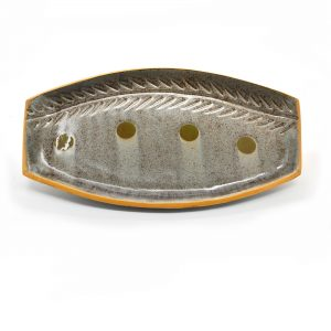 small ceramic platter with carvings and glaze circles