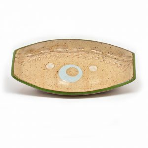small handcrafted ceramic tan tray with circles and carvings
