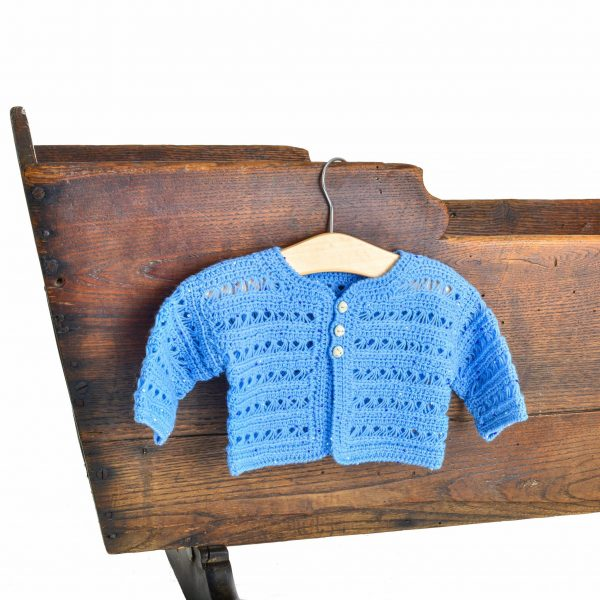 blue handknitted baby cardigan sweater