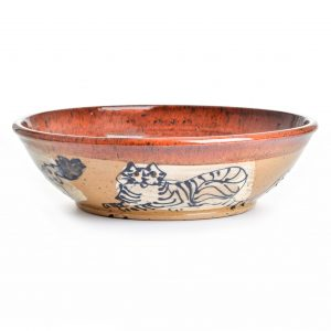 handmade ceramic bowls with cats drawn on the outside with brown interior glaze