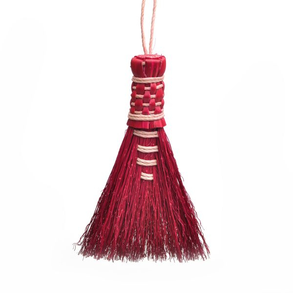 small handheld wisk broom in red, green and natural