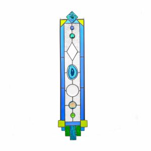 handcrafted tall stained glass panel with green and blue with geode slice