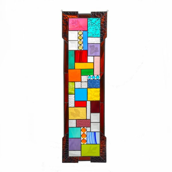 large handmade stained glass panel with different colors and etched leaves