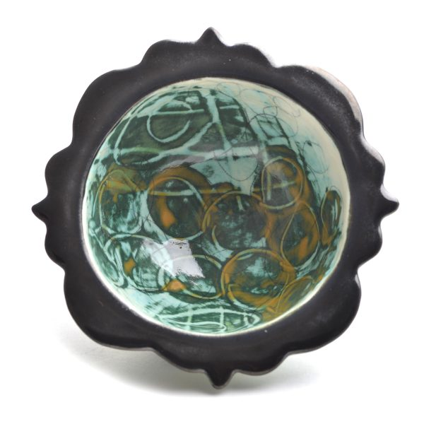 Handmade wheel thrown small bowl with cut black rim with green and yellow decorated interior and exterior, nc clay, nc pottery, wheel throwing