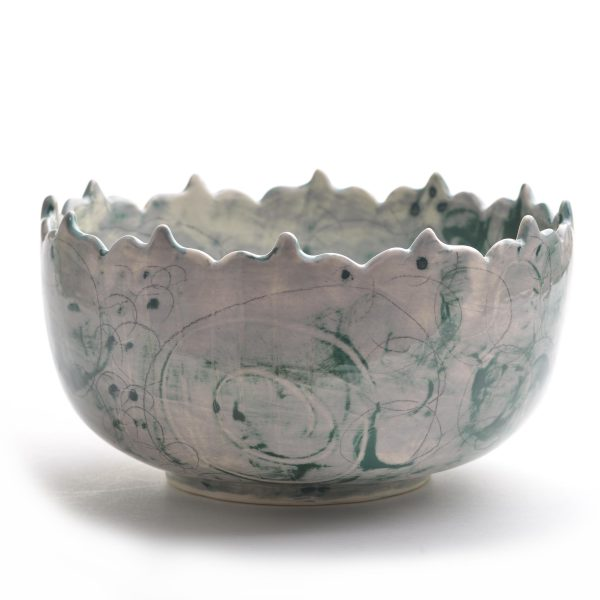 side view of cut rim gray and green wheel thrown fancy serving bowl