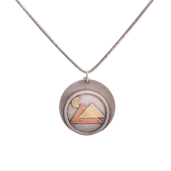 round metal sterling silver necklace handmade with mixed metals mountain scene on silver chain