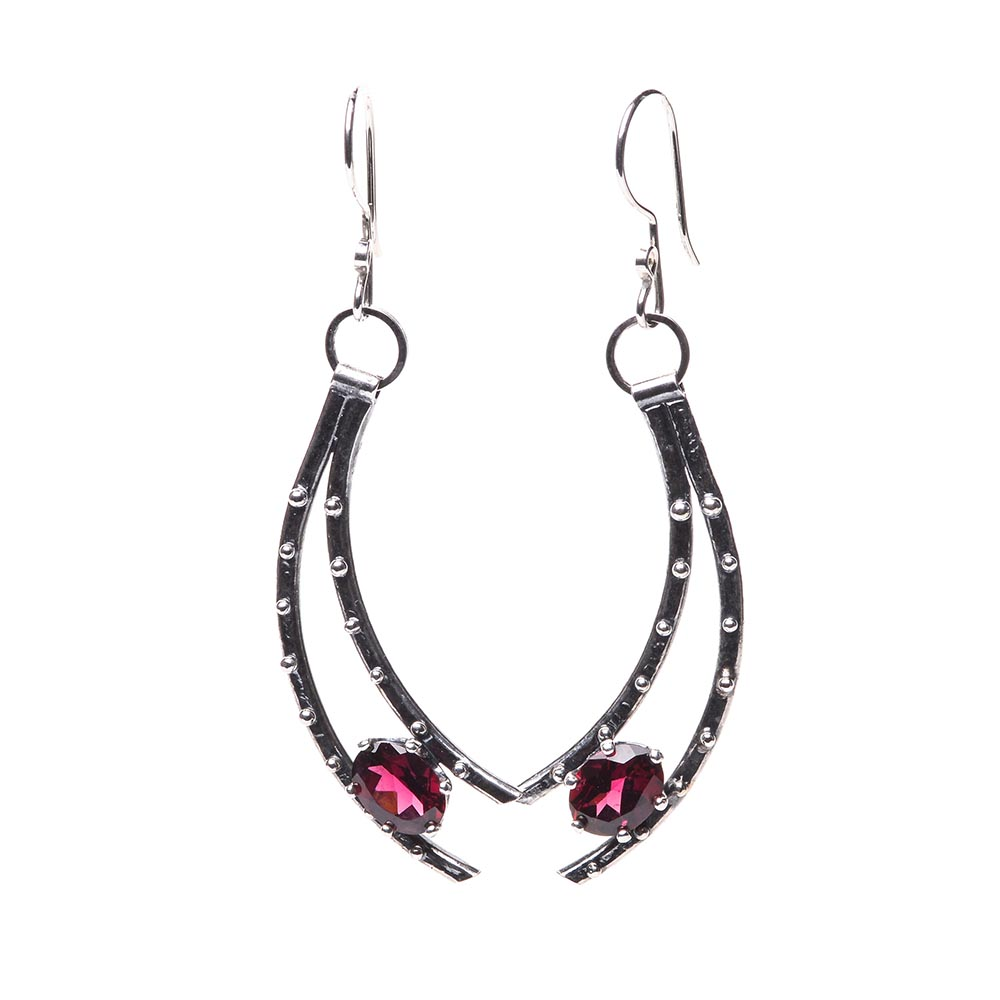 garnet and silver earrings, curved silver earrings holding a faceted garnet at the bottom, handmade forged silver earrings with garnet, fancy jewelry, asheville jeweler
