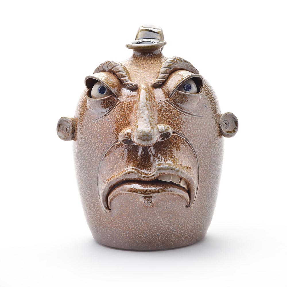 front view of salt fired face jug, traditional nc clay, folk art pottery,