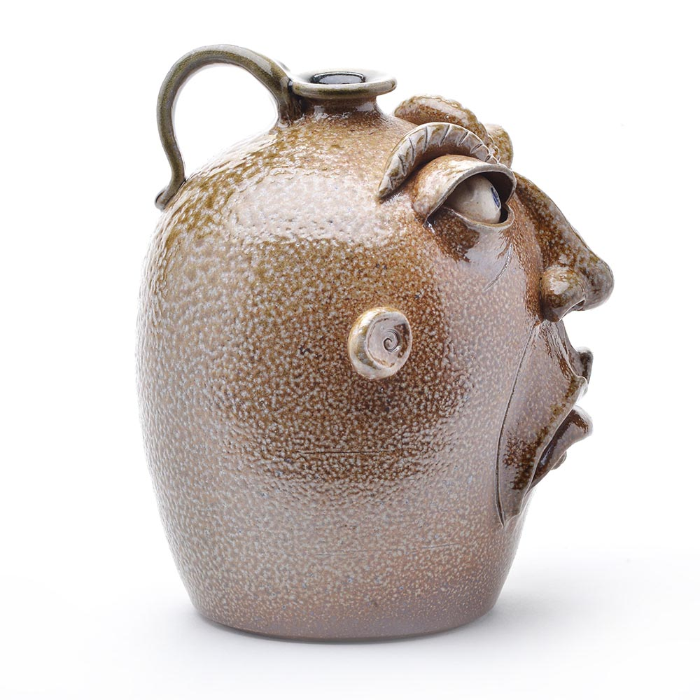 side view of salt fired face jug, nc clay