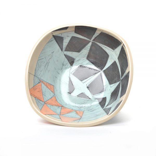 inside view of handmade ceramic bowl with light blue black and orange patterns