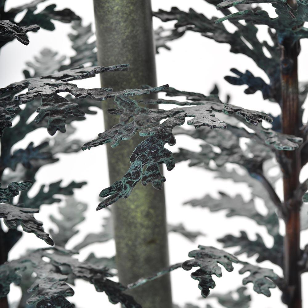cedar leaves on forged handmade lamp