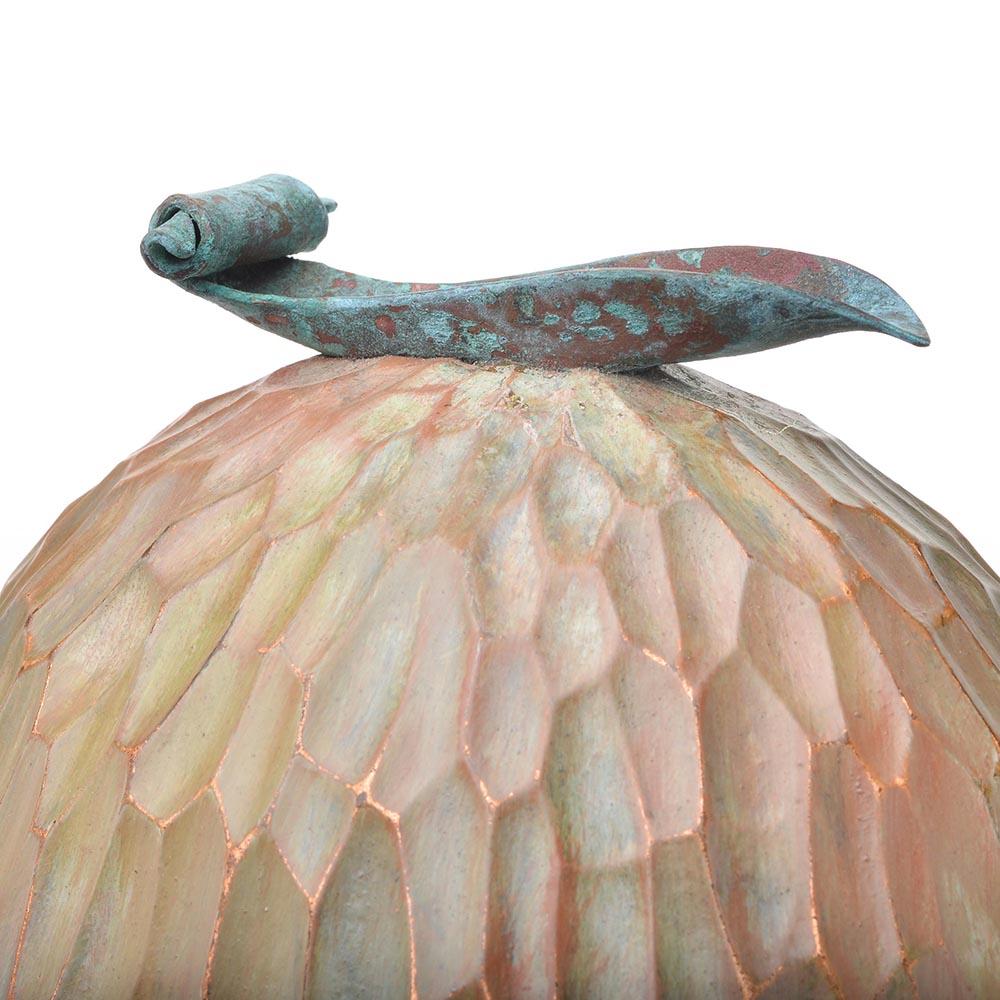 detail of copper foil leaf on top of turned wood sculpture