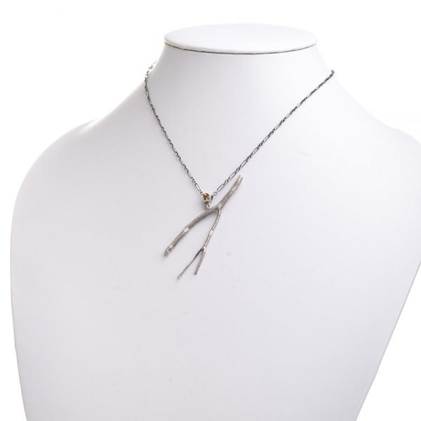 twig and citrine necklace on white neck stand