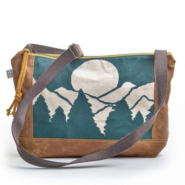 mountain vista printed canvas bag, teal mountain scene printed on a large rectangular shoulder crossbody bag
