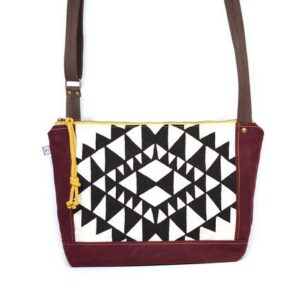 red waxed canvas crossbody bag with black and white printed pattern, vegan canvas bag