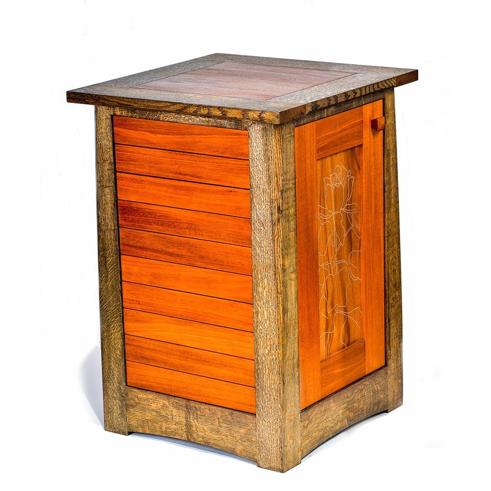side view of handmade wooden cabinet, dark wood corners with brighter door, nc woodworker, handmade furniture