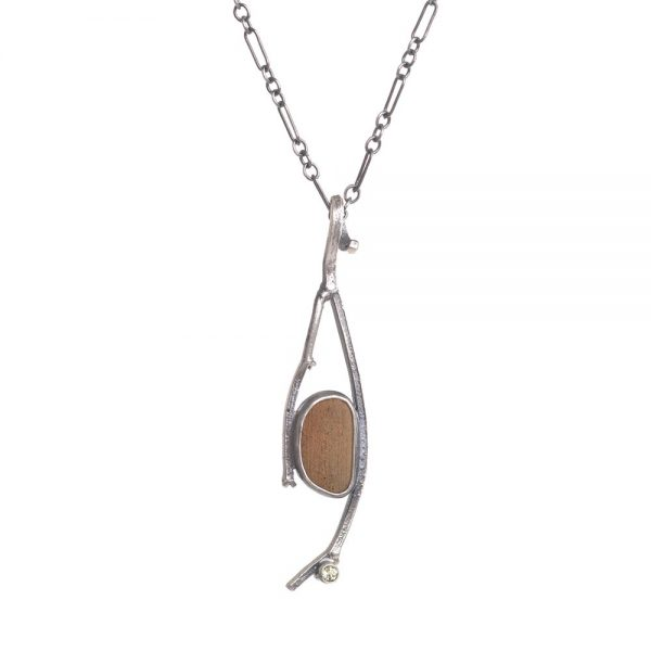 cast silver stick necklace with peridot and river stone, jason janow jewelry
