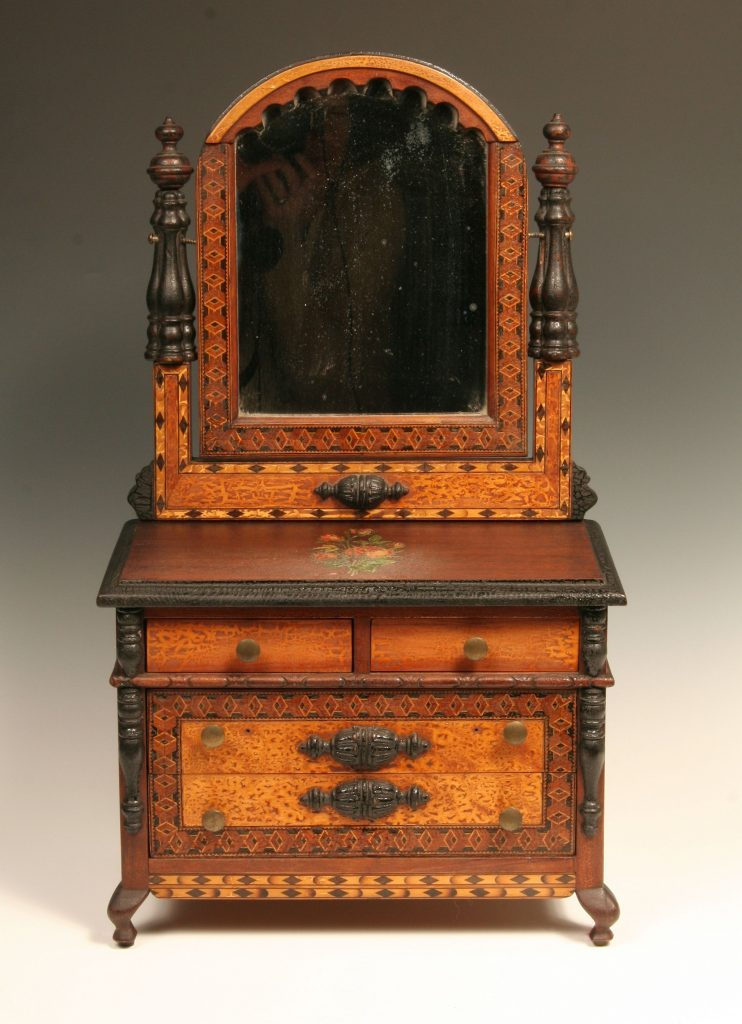 Miniature Bureau with Mirror, c. 1940, four drawer bureau in walnut wood with wood inlay, six brass knobs.