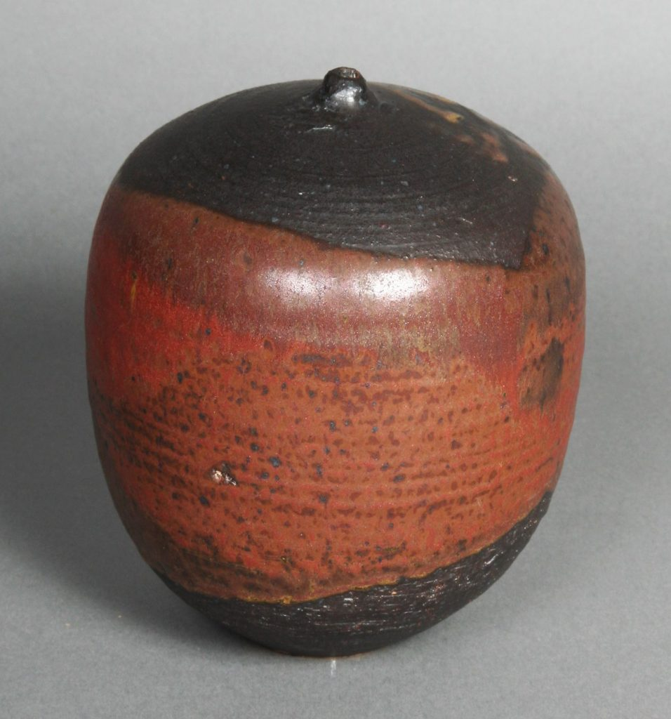 Vessel, c. 1950, Toshiko Takaezu, earthenware - mouth of vessel is closed into a very narrow neck. Raku glazes applied that are reminiscent of an expressionist painting.