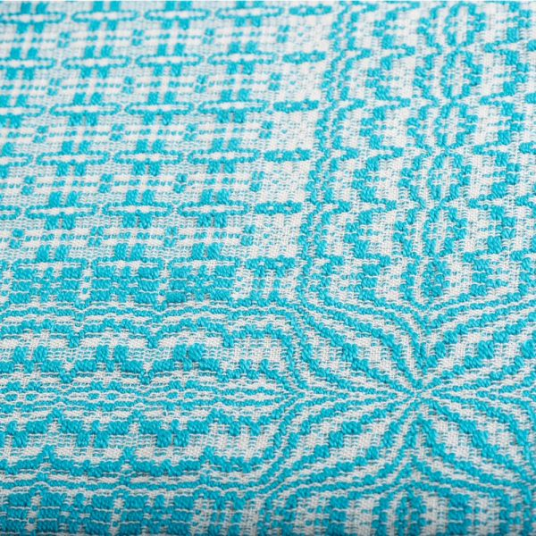 turquoise and white handwoven table runner