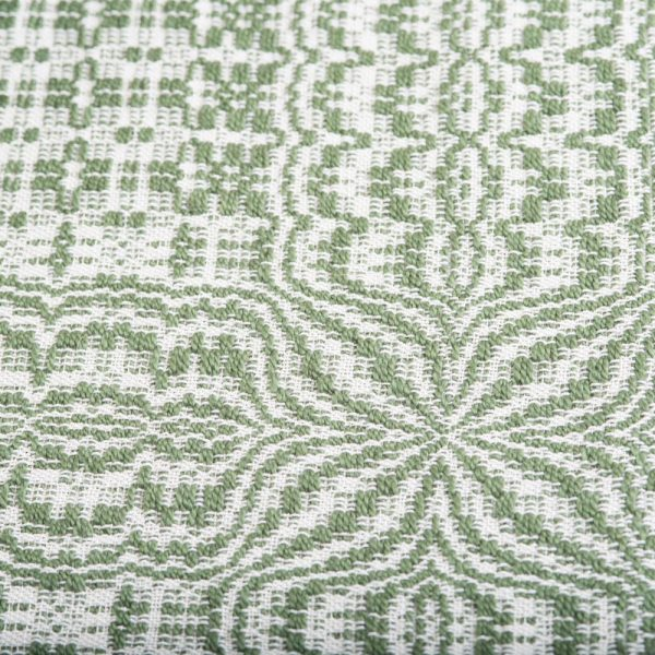 green and white handwoven table runner detail