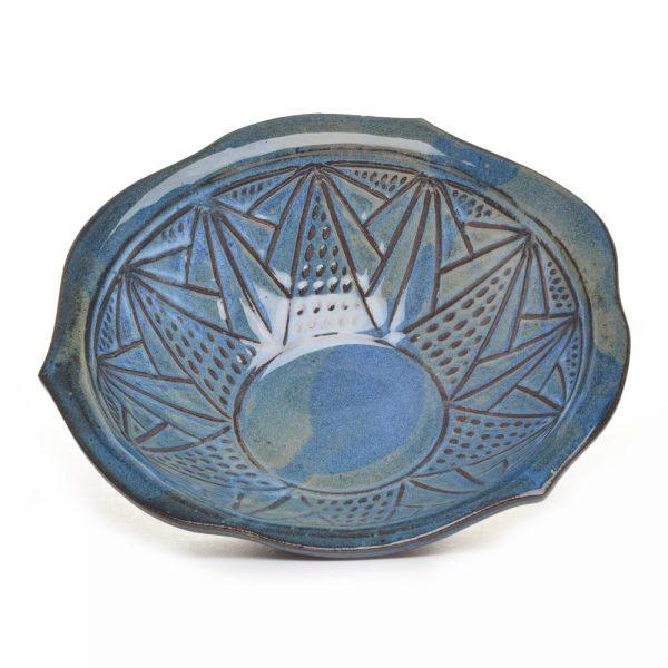 inside view of carved blue green bowl, large serving bowl
