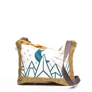 waxed canvas cross body bad with white and teal mountain decoration,