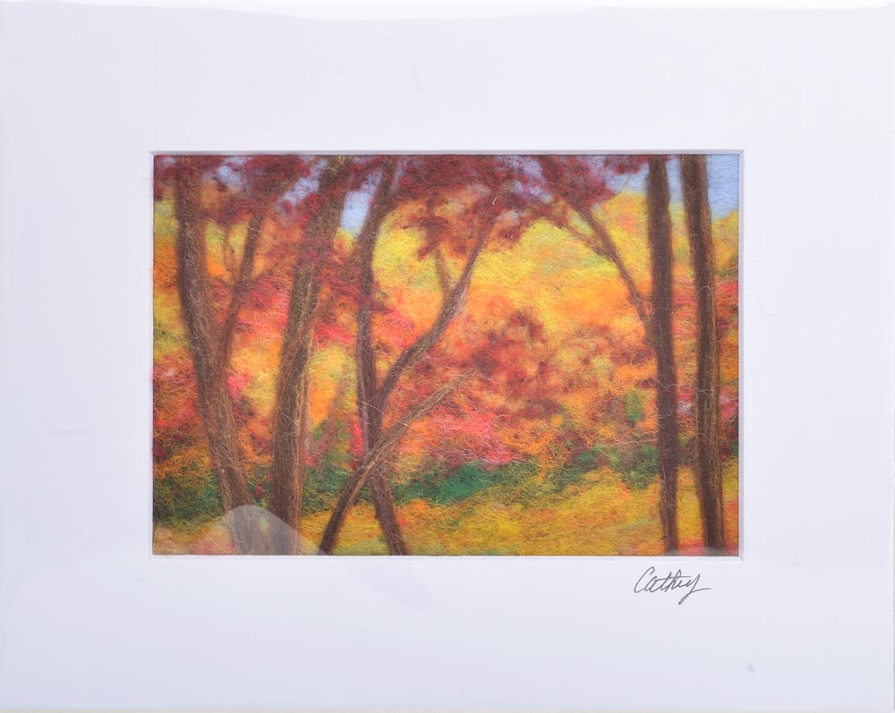 fall felted landscape made with orange colored felt,