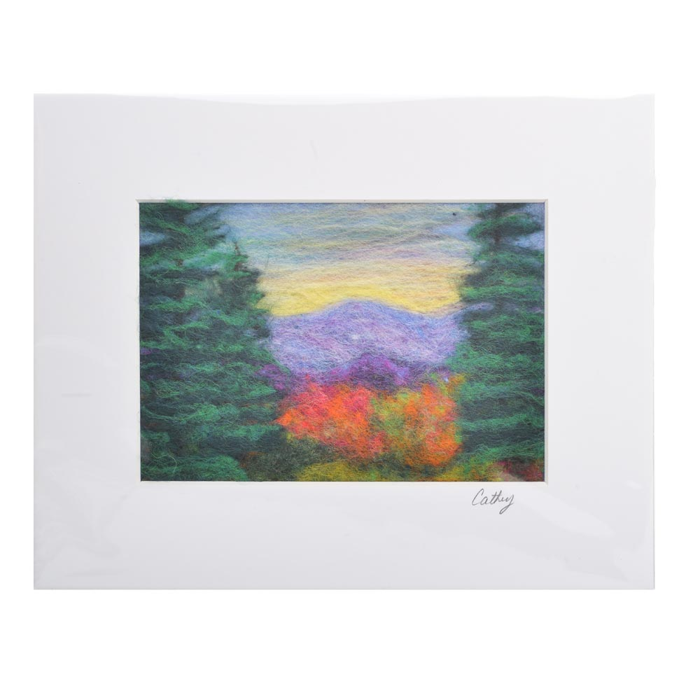 small matted mountain view made with different colors of felt, fiber landscape