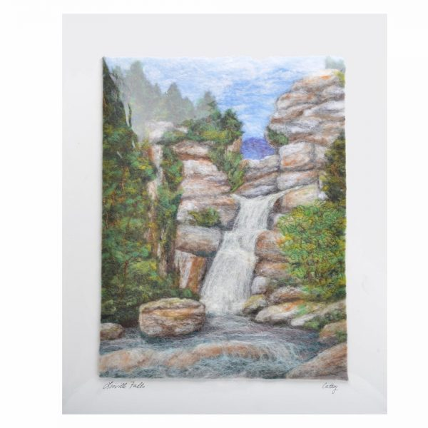 linville falls felted landscape, different colors of felt are layered to create a colorful waterfall mountain scene,