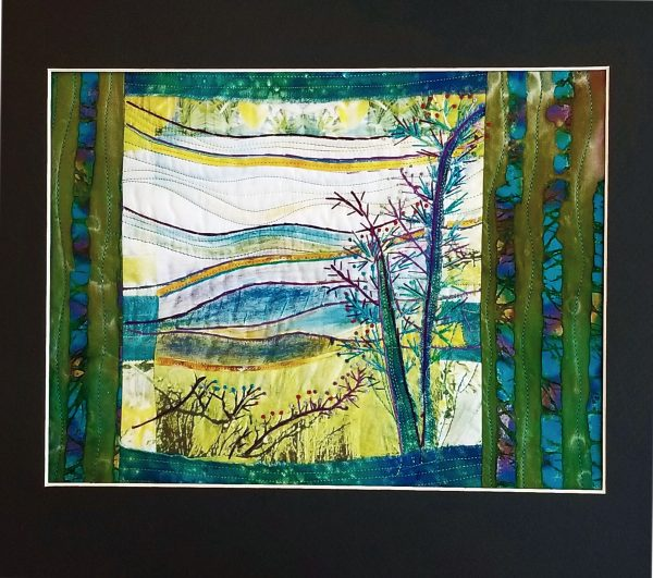 green and blue embroidered and quilted mountain scene, green and blues on fabric