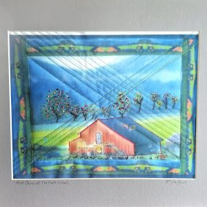 hand embroidered photograph printed on cotton, image of the red barn at john c campbell folk school,