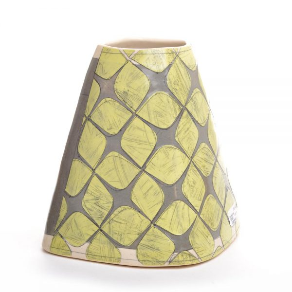 chartreuse patterns on handmade ceramic vase with patterns