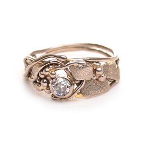 asymmetrical gold and diamond ring