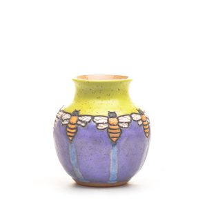 short ceramic vase with purple, chartreuse and bees
