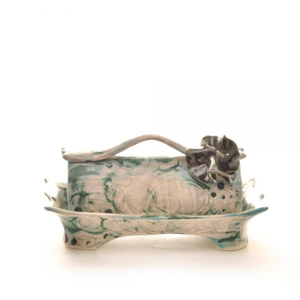 handmade ceramic butter dish with blue green glaze and green flower